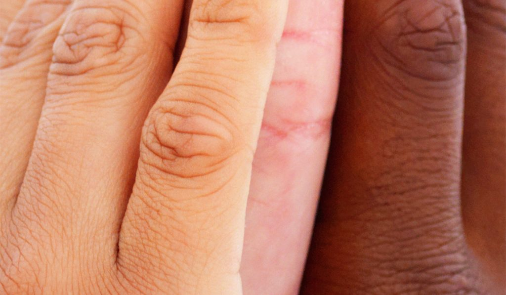 Close-up of human hands showing unity
